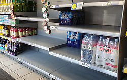 © Licensed to London News Pictures. 22/07/2021. London, UK. Nearly empty shelves of drinking bottled water in Tesco Express in Tottenham, north London after food shortage fears due to the pingdemic. A number of supermarkets are reporting empty shelves as they, wholesalers and hauliers are struggling to ensure food and fuel supplies after the Covid-19 NHS app alerted workers to isolate after being in contact with someone with COVID-19. Photo credit: Dinendra Haria/LNP