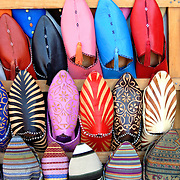 Traditional hand made leather shoes for sale in the souks of Marrakech, Morocco.