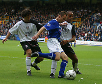 Photo: Jo Caird<br /> Fulham v Leicester<br /> Loftus Rd<br /> Barclaycard Premiership 2003<br /> 04/10/2003.<br /> <br /> Paul Dickov attacks Fulham