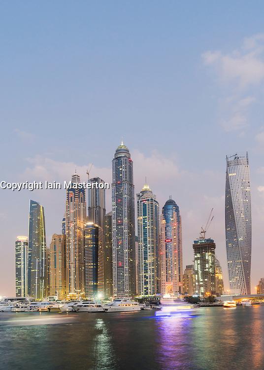 Skyline at dusk of skyscrapers in Marina district in Dubai United Arab Emirates