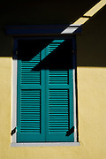 Yellow house with turquoise shutters in the French Quarter in New Orleans, Louisiana.