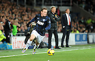 Wayne Rooney takes the ball forward for Manchester United.<br /> Barclays Premier League match, Cardiff city v Manchester Utd at the Cardiff city stadium in Cardiff, South Wales on Sunday 24th Nov 2013. pic by Phil Rees, Andrew Orchard sports photography,