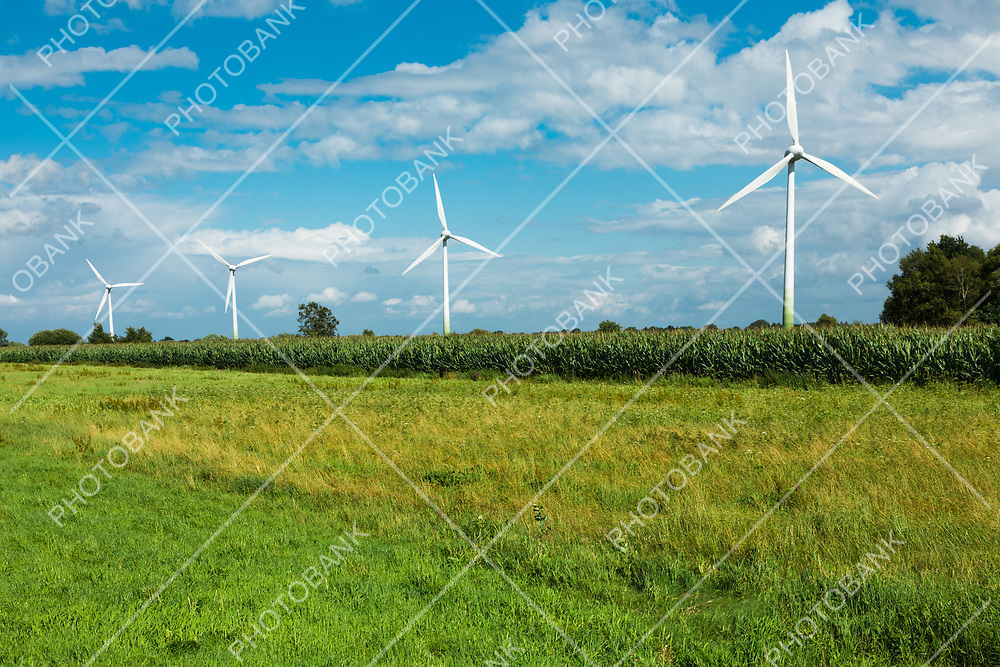 wind blade surrounded by green fields