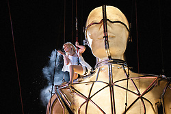 © licensed to London News Pictures. London, UK 22/06/2012. A disabled performer on ten-metre high Prometheus puppet as a theatrical event takes place outside National Maritime Museum last night as part of the London 2012 Festival. The showcase is the first ever large-scale outdoor theatre production in the UK that is led by disabled artists. Photo credit: Tolga Akmen/LNP