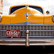 Bisbee, Arizona is known for being an eclectic town filled with eccentric artists, musicians and folks looking to get away from it all. The former copper and silver mining town now focuses its energy on tourism. An old taxi is parked on a side street in Bisbee, AZ.
