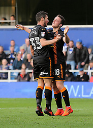 Wolves' Leo Bonatini scores his sides first goal and celebrates with Diogo Jota, levelling the score at 1-1 during the Sky Bet Championship match at Loftus Road, London.