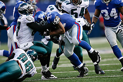 11 Jan 2009: Philadelphia Eagles safety Quintin Mikell #27 stops New York Giants running back Ahmad Bradshaw #44 during the game against the New York Giants on January 11th, 2009.  The  Eagles won 23-11 at Giants Stadium in East Rutherford, New Jersey. (Photo by Brian Garfinkel)