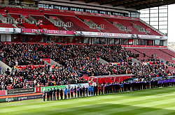 Stoke City fans, players and staff applaud as the Gordon Banks funeral cortege passes through the bet365 Stadium, Stoke.