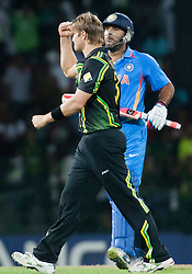 © Licensed to London News Pictures. 28/09/2012. Australian bowler Shane Watson celebrates after getting the wicket of Yuvraj Singh during the T20 Cricket World cup match between Australia Vs India at the R.Premadasa Cricket Stadium,Colombo. Photo credit : Asanka Brendon Ratnayake/LNP