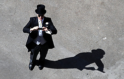 A Racegoer takes a picture during day four of Royal Ascot at Ascot Racecourse.