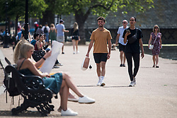 © Licensed to London News Pictures. 12/06/2021. London, UK. Members of the public enjoy the warm weather in Hyde Park, central London on another hot summer's day. This weekend is expected to be the hottest of the year so far. Photo credit: Ben Cawthra/LNP
