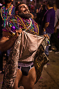Begging for beads on Bourbon Street during Mardi Gras on 25th February 2020 in New Orleans, Louisiana, United States. Mardi Gras is the biggest celebration the city of New Orleans hosts every year. The magnificent, costumed, beaded and feathered party is laced with tradition and  having a good time. Celebrations are concentrated for about two weeks before and culminate on Fat Tuesday the day before Ash Wednesday and Lent. Wearing less clothing than considered decent in other contexts during Mardi Gras has been documented since 1889, when the Times-Democrat decried the degree of immodesty exhibited by nearly all female masqueraders seen on the streets. Risqué costumes, including body painting, is fairly common. Social scientists studying ritual disrobement found, at Mardi Gras 1991, 1,200 instances of body-baring in exchange for beads or other favours.