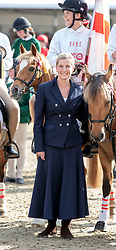 The Countess of Wessex with the winning team in the DAKS Pony Club Mounted games Royal Windsor Horse Show at Windsor Castle, Berkshire.