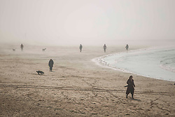 © Licensed to London News Pictures.  20/04/2021. Margate, UK. Members of the public enjoy sunny and foggy afternoon by the beach in Margate, east Kent. As a mini heatwave is forecast to hit parts of UK this week with high temperatures reaching 22 celsius. Photo credit: Marcin Nowak/LNP