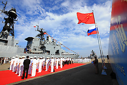ZHANJIANG, Sept. 12, 2016 (Xinhua) -- Officers and soldiers of Chinese Navy hold a welcome ceremony as a Russian fleet arrive at a port in Zhanjiang, south China's Guangdong Province, Sept. 12, 2016. A Russian fleet arrived in Zhanjiang on Monday, with Chinese naval forces gathering for a joint drill. The ''Joint Sea 2016'' drill will go ahead between September 12 and 19 in the South China Sea, off Guangdong. (Xinhua/Zha Chunming) (zhs) (Credit Image: © Zha Chunming/Xinhua via ZUMA Wire)