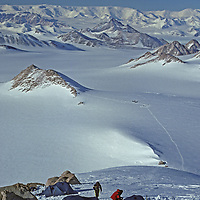 ANTARCTICA, Mount Vaughan Expedition. Camp I (Camp Goodale) on north ridge of Mount Vaughan.  Base camp with Twin Otter ski planes bkg.