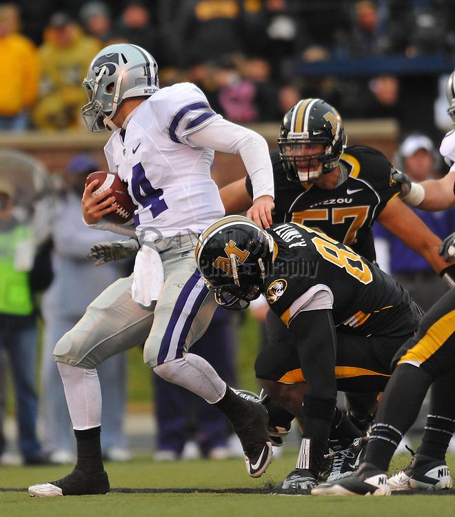 Nov 13, 2010; Columbia, MO, USA; Kansas State Wildcats quarterback Carson Coffman (14) is sacked by Missouri Tigers defensive lineman Brad Madison (57) and defensive end Aldon Smith (85) in the second half at Memorial Stadium. Missouri won 38-28.  Mandatory Credit: Denny Medley-US PRESSWIRE