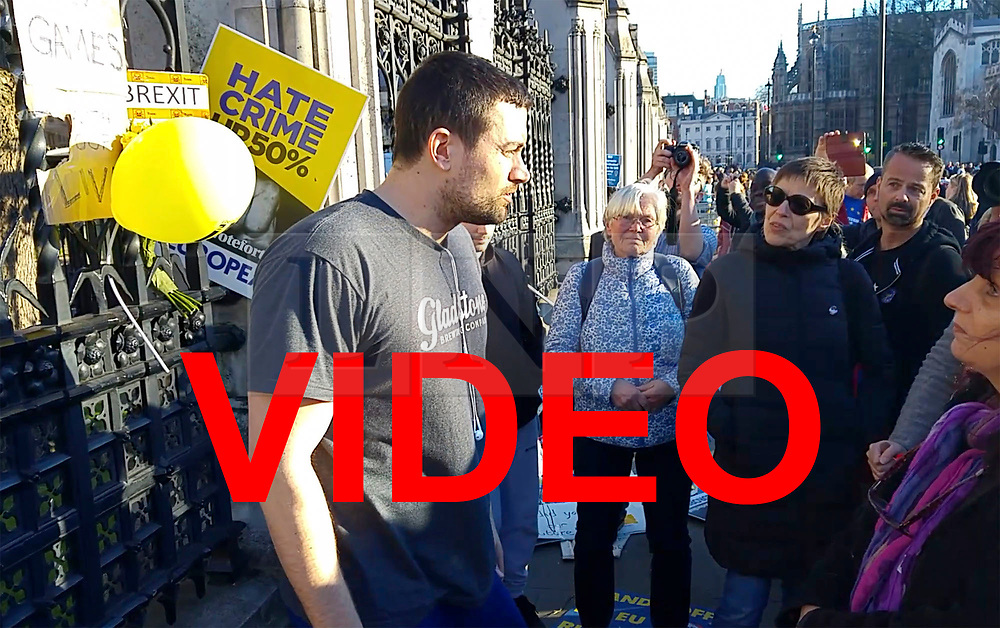 ** VIDEO HERE: https://we.tl/t6yZju5yXx<br /> <br /> © Licensed to London News Pictures . 25/03/2017. London ,UK . A man remonstrates with pro EU supporters outside the Houses of Parliament, when anti-brexit/ proEU banners are attached near flowers left for the victims of the Westminster terrorism attack, following a Unite for Europe anti Brexit march through central London. The man, who also tells the demonstrators to respect the referendum vote, is eventually moved on by police. Photo credit : Joel Goodman/LNP