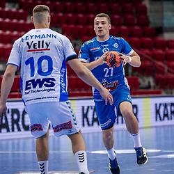 Jerome Mueller (TVB Stuttgart #27) ; Sebastian Heymann (FRISCH AUF! Goeppingen #10) ; LIQUI MOLY HBL 20/21  1. Handball-Bundesliga: TVB Stuttgart - FRISCH AUF! Goeppingen am 24.04.2021 in Stuttgart (SCHARRena), Baden-Wuerttemberg, Deutschland,<br /> <br /> Foto © PIX-Sportfotos *** Foto ist honorarpflichtig! *** Auf Anfrage in hoeherer Qualitaet/Aufloesung. Belegexemplar erbeten. Veroeffentlichung ausschliesslich fuer journalistisch-publizistische Zwecke. For editorial use only.