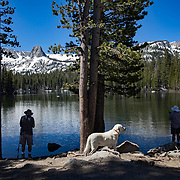 Fishermen enjoy the scenery while fishing Lake Mamie in Mammoth, CA with Crystal Crag in the background.