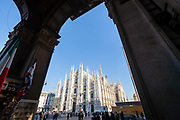 People walk and gather in front of the Cathedral in Piazza del Duomo in central Milan on 8th December 2008 in Milan, Italy. The cathedral, or duomo took six centuries to build and occupies the heart of the city, and attracts visitors from all over the world.
