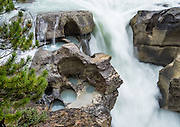 Lower Sunwapta Falls, in Jasper National Park, Canadian Rockies, Alberta, Canada. Jasper is the largest national park in the Canadian Rocky Mountain Parks World Heritage Site declared by UNESCO in 1984.
