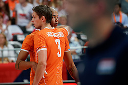 21-09-2019 NED: EC Volleyball 2019 Netherlands - Germany, Apeldoorn<br /> 1/8 final EC Volleyball / Nimir Abdelaziz #14 of Netherlands, Maarten van Garderen #3 of Netherlands