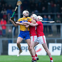 Clare's Aaron Shanager in action against Cork's defence