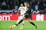 Manchester United Midfielder Scott McTominay battles with Kylian Mbappe of Paris Saint-Germain during the Champions League Round of 16 2nd leg match between Paris Saint-Germain and Manchester United at Parc des Princes, Paris, France on 6 March 2019.