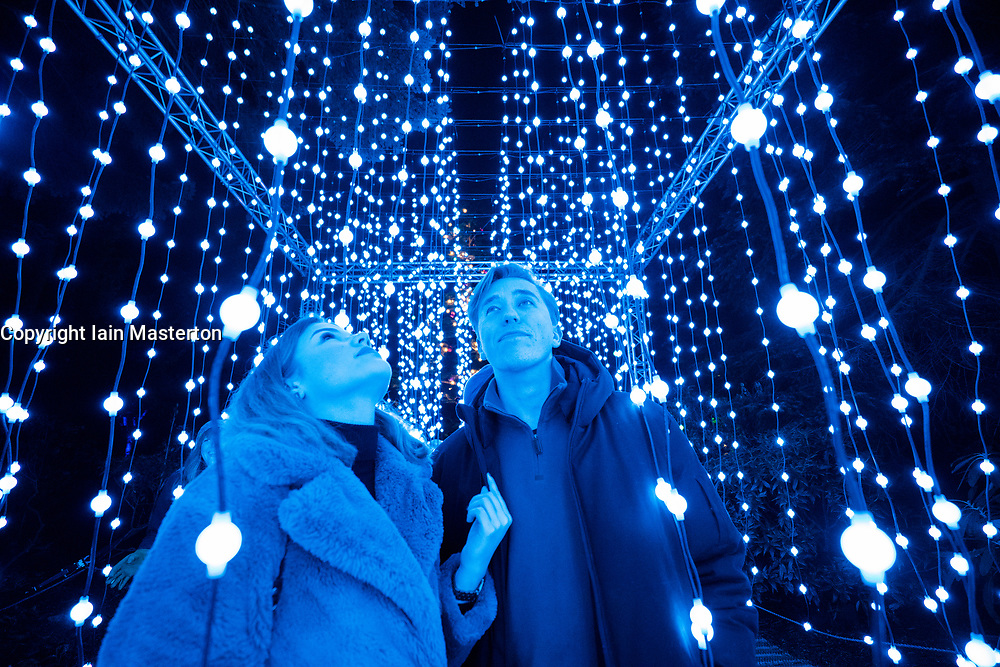 Edinburgh, Scotland, UK. 23 November, 2018. Christmas at the Botanics opens at the Royal Botanic Garden Edinburgh. The annual night event features an illuminated trail through the gardens with over a million lights. Pictured, Feast of Light, a large immersive walkthrough experience created by Squidsoup. It uses individual points of suspended lights to create feelings of presence and movement within physical space.