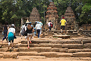 A group of Asian tourists walk on the ancient ruins and towards Preah Ko temple, Roluos, Svay Chek District, Banteay Meanchey Province, Cambodia, South East Asia. The towers are made of brick and perched on a sandstone platform. (photo by Andrew Aitchison / In pictures via Getty Images)