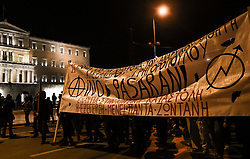Protesters stand outside the Greek parliament during a demonstration,  in Athens, Greece on Friday, December. 6, 2019 commemorating the killing of 15-year-old student Alexandros Grigoropoulos by a police officer in 2008. Authorities are closing off main roads and have tightened security in the Greek capital.<br /> <br /> Pictured: <br /> Dimitris Lampropoulos  | EEm date