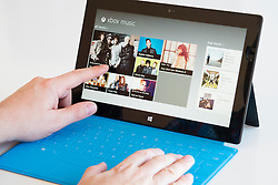 Man browsing the Xbox music store on a Microsoft Surface rt tablet computer