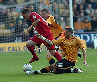 Photo: Kevin Poolman.<br />Wolverhampton Wanderers v Colchester United. Coca Cola Championship. 14/10/2006. Craig Davies puts in a tackle on Colchester's Kevin McLeod.