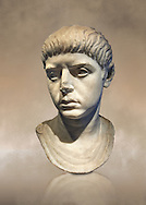 Roman portrait bust of a young man from the reign of Nero, 54-68 AD. This portrait can be dated to the reign of Nero due to the facial features and hair style, with short locks and long fringe over the forehead. The young man is wearing a tunic, stopped with a small fibula (clasp) on the left shoulder. Inv 281, The National Roman Museum, Rome, Italy .<br /> <br /> If you prefer to buy from our ALAMY PHOTO LIBRARY  Collection visit : https://www.alamy.com/portfolio/paul-williams-funkystock/roman-museum-rome-sculpture.html<br /> <br /> Visit our ROMAN ART & HISTORIC SITES PHOTO COLLECTIONS for more photos to download or buy as wall art prints https://funkystock.photoshelter.com/gallery-collection/The-Romans-Art-Artefacts-Antiquities-Historic-Sites-Pictures-Images/C0000r2uLJJo9_s0
