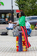 Wilkes-Barre, PA (July 11, 2020) -- Carmen Tinson wears an African American Flag as a cape during the Back Lives Matter NEPA United Movement event at Wilkes-Barre Public Square.