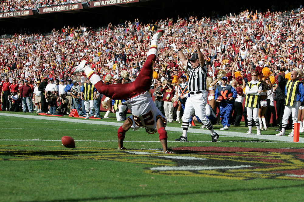 Jay Westcott/Examiner     SP   Oct. 23, 2005 - Washington Redskins vs. San Francisco 49ers. - #26 Clinton Portis cartwheels in the end zone after scoring his third rushing touchdown of the game.