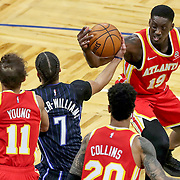 ORLANDO, FL - MARCH 03: Michael Carter-Williams #7 of the Orlando Magic and Tony Snell #19 of the Atlanta Hawks fight for the ball as Trae Young #11 of the Atlanta Hawks and John Collins #20 of the Atlanta Hawks look on during the first half at Amway Center on March 3, 2021 in Orlando, Florida. NOTE TO USER: User expressly acknowledges and agrees that, by downloading and or using this photograph, User is consenting to the terms and conditions of the Getty Images License Agreement. (Photo by Alex Menendez/Getty Images)*** Local Caption *** Michael Carter-Williams; Tony Snell; Trae Young;  John Collins