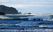 Wind blows spray off the top of breakers on a sunny winter morning after a storm at Hobuck Beach near Cape Flattery. This view looks south toward Olympic National Park and Shi Shi Beach. (Brian J. Cantwell / The Seattle Times)