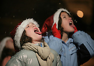 Pine Bush, NY - Children try to catch snowflakes during the Pine Bush Festival of Lights on Dec. 5, 2009.