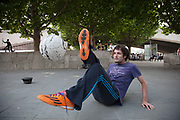 Football trick street performer Alex, performs tricks for money. The South Bank is a significant arts and entertainment district, and home to an endless list of activities for Londoners, visitors and tourists alike.