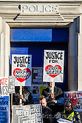 "Supporters of Mark Duggan's family hold a vigil outside Tottenham  police station. They gathered, alongside family members and his mother Pam Duggan, at 2pm following an inquest jury ruling that Duggan was lawfully killed when police shot him dead while he was unarmed.  Within days of his shooting, in 2011, rioting broke out on the streets of London, and spread to other urban areas in England.  Pastor Nims Obunge, who oversaw Duggan's funeral in 2011, said: ""The message from the family is that this vigil is intended to be a very peaceful vigil"". Tottenham, London, UK 11 January 2014. Guy Bell, 07771 786236, guy@gbphotos.com"