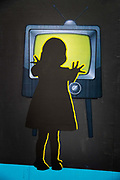 Painting of girl touching TV from the Shangri La field, Glastonbury Festival 2016. The Glastonbury Festival is the largest greenfield festival in the world, and is now attended by around 175,000 people. Its a five-day music festival that takes place near Pilton, Somerset, United Kingdom. In addition to contemporary music, the festival hosts dance, comedy, theatre, circus, cabaret, and other arts. Held at Worthy Farm in Pilton, leading pop and rock artists have headlined, alongside thousands of others appearing on smaller stages and performance areas.