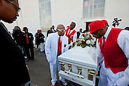"""Pall bearers carry Kevin's casket.<br /> Funeral services for Kevin """"Flipside"""" White at Macedonia Church in Watts.<br /> White was shot dead in what is believed to be an unprovoked attack during a gang conflict at Watts' Nickerson Gardens and Jordan Downs housing projects.<br /> Flipside, 44, was a founding member of Watts' first major label hip hop act, O.F.T.B. (Operation From The Bottom)."""