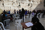 Israel, Jerusalem, Old City, Female Jews pray at the Wailing Wall in the women's section