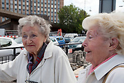 "Two pensioners and friends in Stratford, East London. June Sheridan (right) and Margaret Pavey (left) both live in the East End of Londno, and have done all their lives. June says ""It's horrible, everything is changing and it lways affects the poor not the rich. Everything is going up in price, there is nothiing that isn't £3-8. Where would I be without my daughter to help, and buy me lunch. If I didn't have her, I'd have to move away."" Margaret says ""Every time you go to the shops everyting has gone up, and not just by 1 or 2 pence, but 10p, 50p. Where do they think pensioners get their money from? Nothing they spend is on us, it's just the Olympics an we won't even be able to go."" This is a relatively poor area of London, but in recent years has seen much regeneration, the construction of a major transport hub and various shopping complexes. Stratford is adjacent to the London Olympic Park and is currently experiencing regeneration and expansion linked to the 2012 Summer Olympics. (Photo by Mike Kemp/For The Washington Post)"