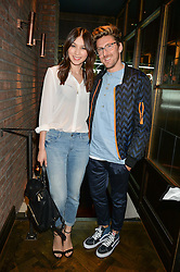 GEMMA CHAN and HENRY HOLLAND at a party to celebrate the launch of Sackville's Bar & Grill, 8a Sackville Street, London on 15th July 2015.