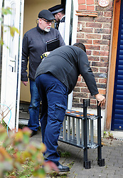 © Licensed to London News Pictures.13/04/2018<br /> HITHER GREEN, UK.<br /> TWO WORKMEN LEAVING THE PROPERTY WITH A POLICEMAN<br />  Hither Green Burglary Murder. South Park Crescent,Hither Green.<br />  Home of 78 year old Richard Osborn-Brooks who stabbed a burglar to death in his home.<br /> Photo credit: Grant Falvey/LNP
