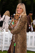 Linda  Barker and 'Lily'. Macmillan Dog Day in aid of Macmillan Cancer Relief. Royal Hospital Chelsea, 5 July 2005. ONE TIME USE ONLY - DO NOT ARCHIVE  © Copyright Photograph by Dafydd Jones 66 Stockwell Park Rd. London SW9 0DA Tel 020 7733 0108 www.dafjones.com