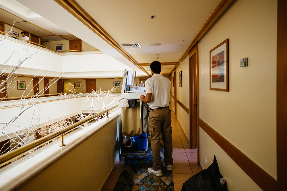 An unidentified Jordanian employee is seen after cleaning and preparing a room of the Isrotel Royal Garden Hotel in Eilat, southern Israel, on March 14, 2018.